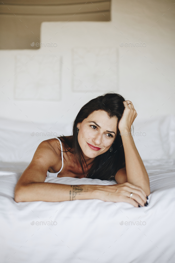 Beautiful woman relaxing in bed - Stock Photo - Images