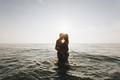 Romantic couple in the sea at sunset - PhotoDune Item for Sale
