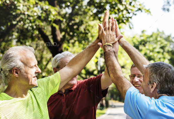 Group of senior athletes giving a high five - Stock Photo - Images