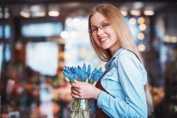 Smiling florist in a store - Stock Photo - Images