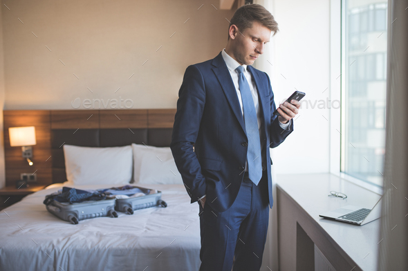 Young businessman in a suit indoors - Stock Photo - Images
