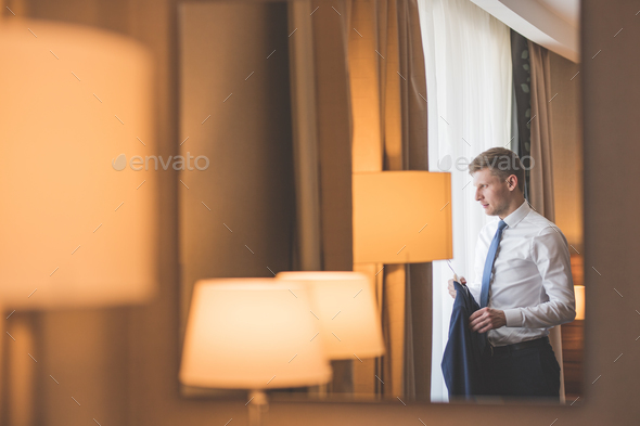 Young groom by the window - Stock Photo - Images