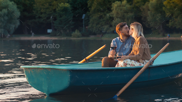 Kissing young couple on vacation - Stock Photo - Images
