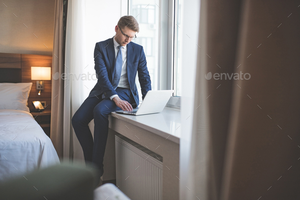 Young businessman in room - Stock Photo - Images