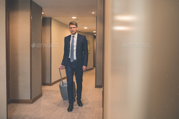 Young businessman in the hall - Stock Photo - Images