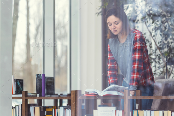 Young girl in the bookstore - Stock Photo - Images