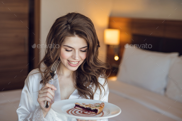 Beautiful girl with breakfast - Stock Photo - Images