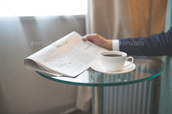 Man's hand with a newspaper - Stock Photo - Images