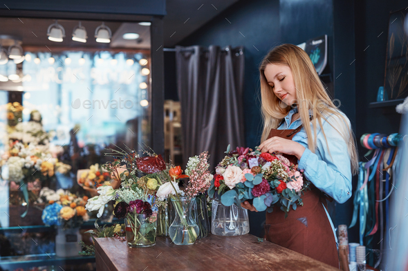 Attractive florist at the counter - Stock Photo - Images