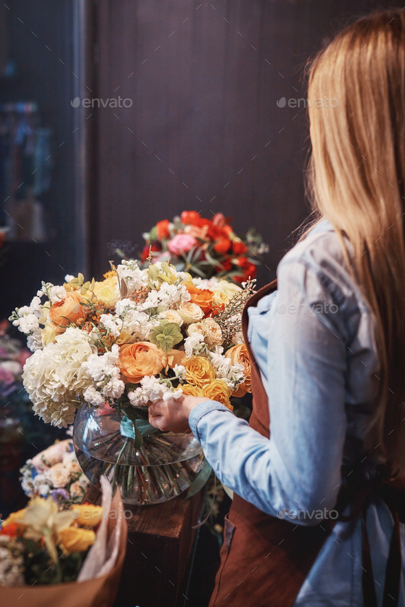 Young florist at work - Stock Photo - Images