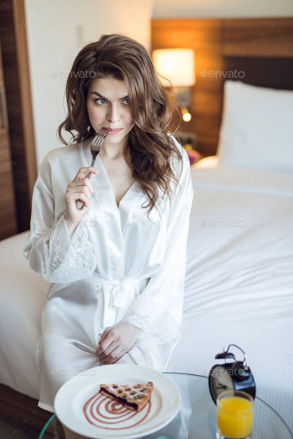Beautiful girl with breakfast in the hotel - Stock Photo - Images