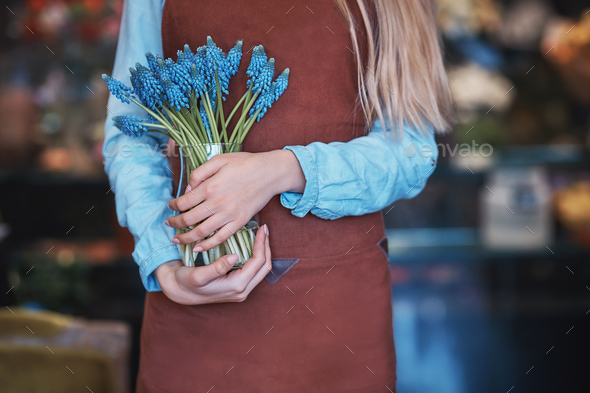 Young woman with blue muscari - Stock Photo - Images