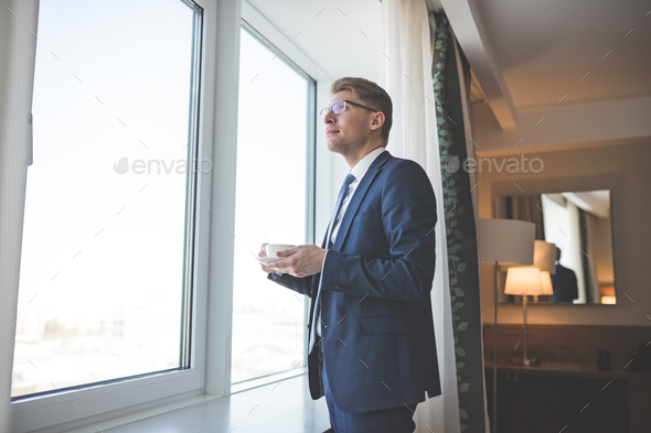 Young businessman with a cup - Stock Photo - Images