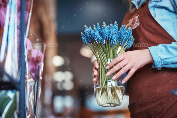 Young woman with muscari - Stock Photo - Images