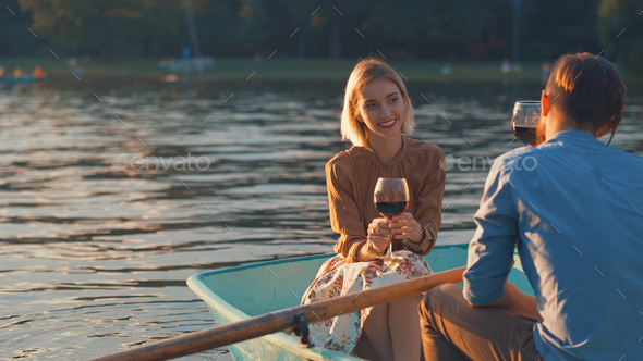 Young couple with a glass of wine outdoors - Stock Photo - Images