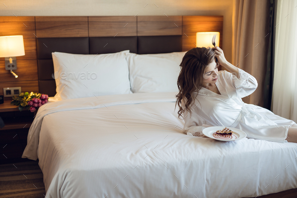 Young bride with breakfast at home - Stock Photo - Images