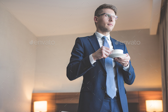 Young businessman in a suit in the hotel - Stock Photo - Images