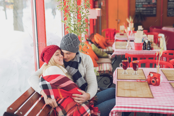Young couple in a cafe - Stock Photo - Images