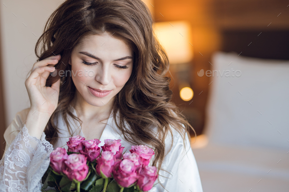 Beautiful bride with a bouquet of roses - Stock Photo - Images