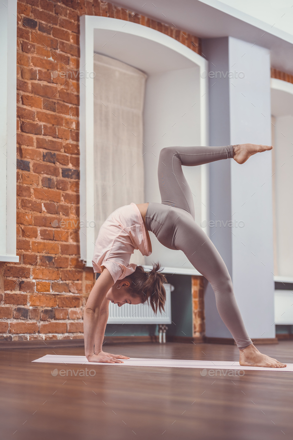 Young woman in yoga class - Stock Photo - Images