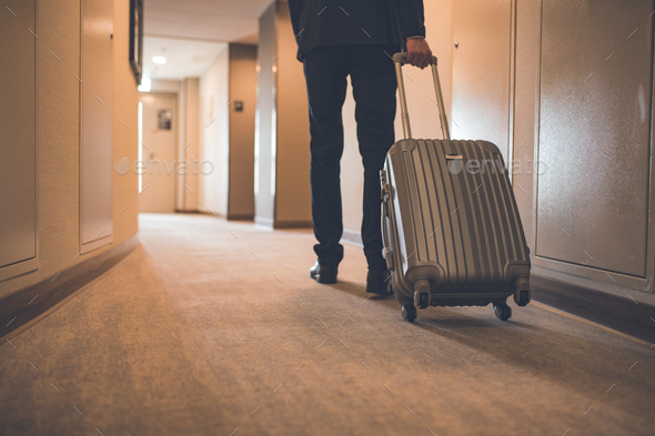 Young businessman with a suitcase - Stock Photo - Images