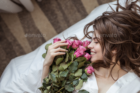 Happy girl with bouquet of flowers - Stock Photo - Images
