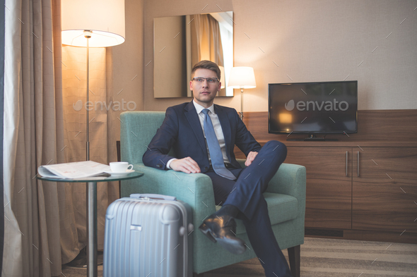Young businessman in a suit in room - Stock Photo - Images