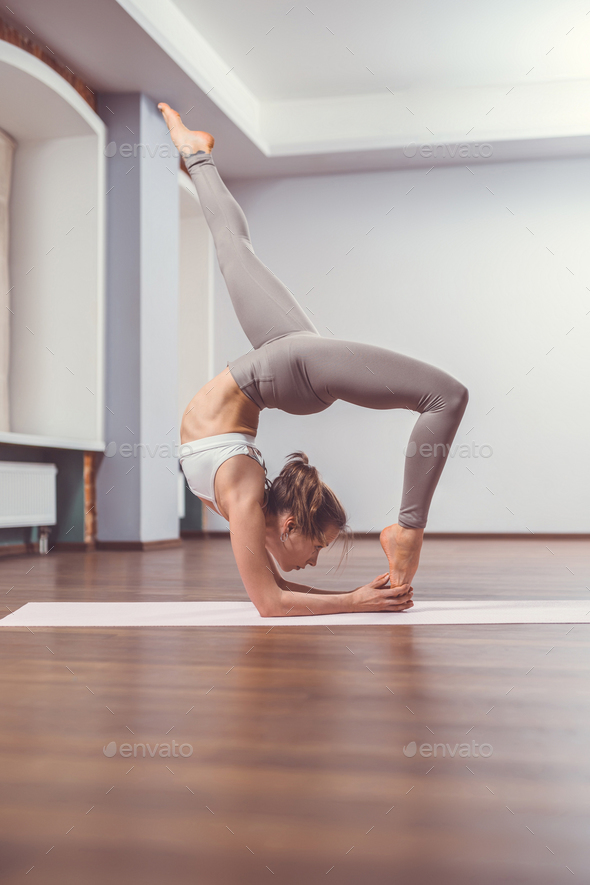 Active young woman doing yoga - Stock Photo - Images