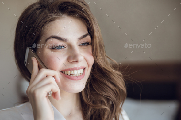 Smiling beautiful girl talking on the phone - Stock Photo - Images