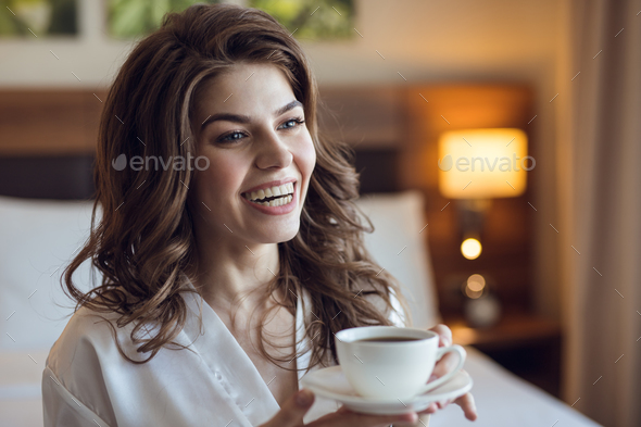 Happy young girl with a cup - Stock Photo - Images