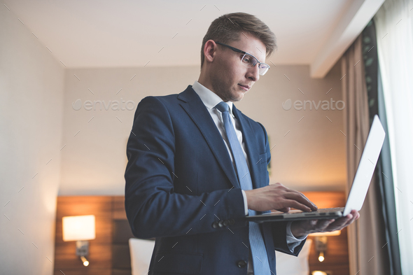 Young businessman in the hotel - Stock Photo - Images