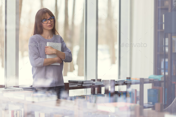 Young woman with a book - Stock Photo - Images