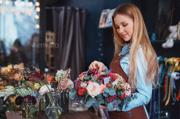 Young florist at the counter - Stock Photo - Images