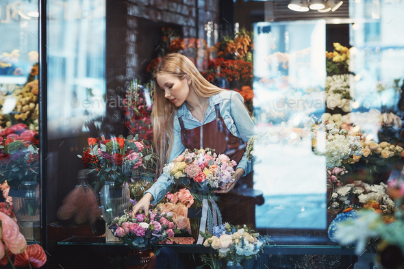 Working florist in a flower shop - Stock Photo - Images