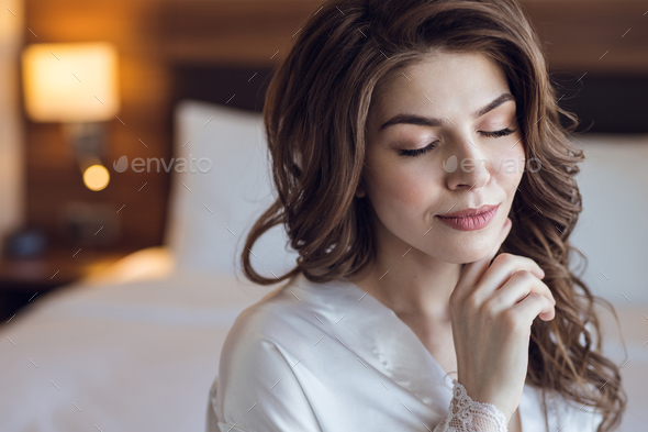 Beautiful young bride in the morning - Stock Photo - Images