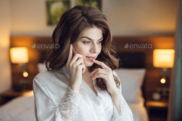 Attractive girl talking on the phone - Stock Photo - Images