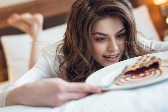 Attractive young girl with a pie - Stock Photo - Images