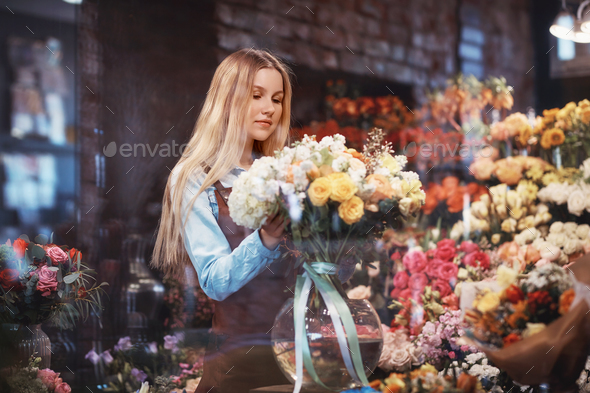Young woman in uniform with flowers - Stock Photo - Images