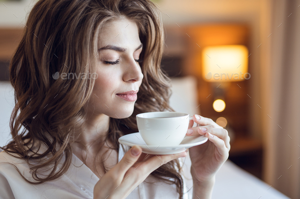 Young girl with a cup of coffee - Stock Photo - Images