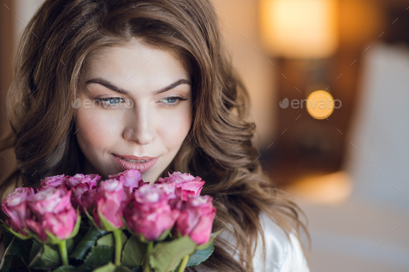 Young girl with a bouquet of roses - Stock Photo - Images