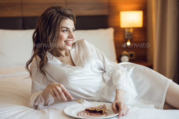 Young bride with breakfast indoors - Stock Photo - Images