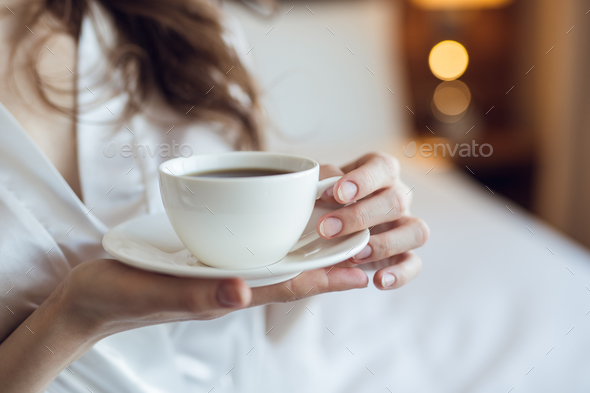 Young woman with a cup - Stock Photo - Images