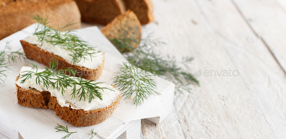 Sandwiches with cream cheese and fresh dill - Stock Photo - Images