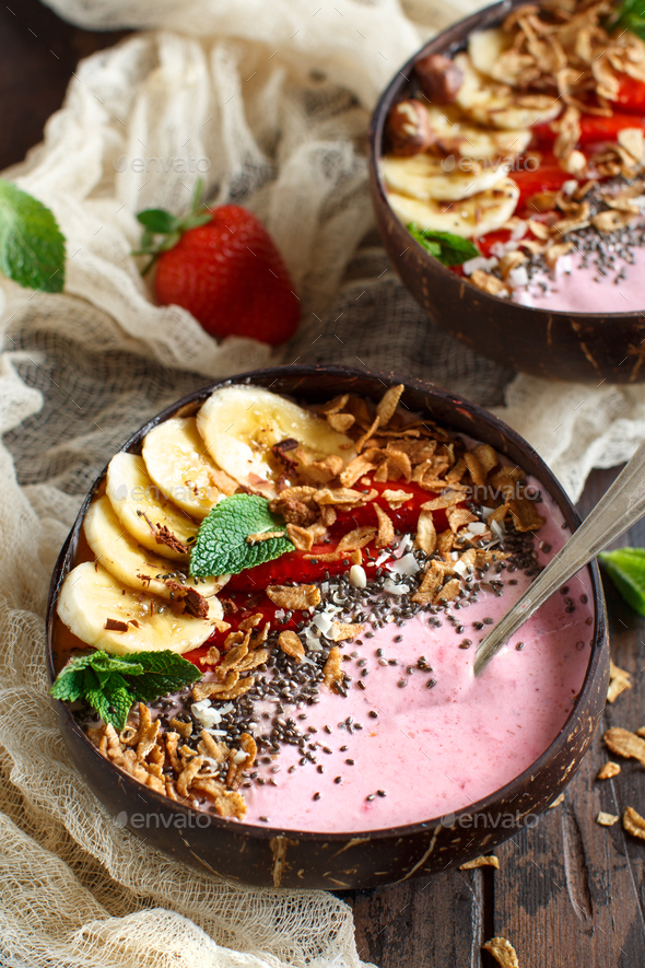 Strawberry and banana smoothie bowls - Stock Photo - Images