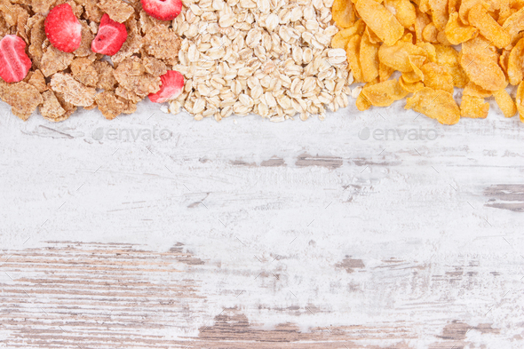 Various mix flakes as source carbohydrates, minerals and fiber, copy space for text on board - Stock Photo - Images