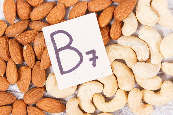 Nutritious almonds and cashew nuts containing vitamin B7 and dietary fiber, healthy nutrition - Stock Photo - Images