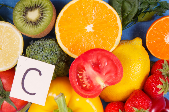 Fruits and vegetables containing vitamin C and natural minerals, healthy nutrition concept - Stock Photo - Images