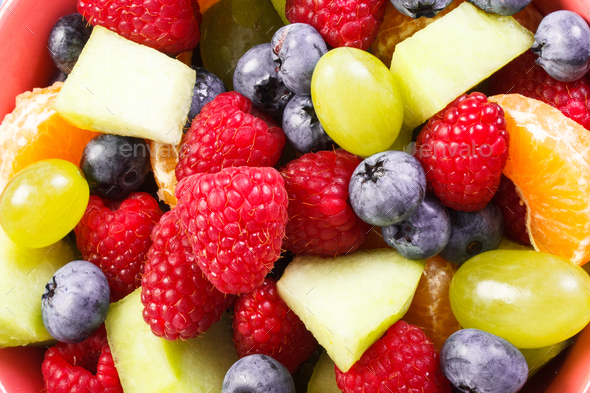 Fresh prepared fruit salad as background, healthy nutrition concept - Stock Photo - Images
