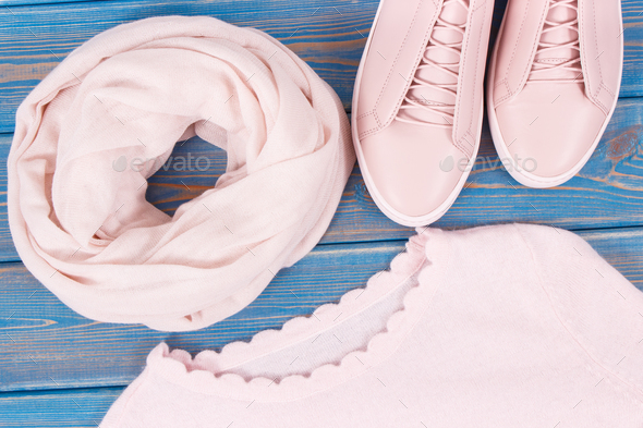 Leather shoes, sweater and shawl for woman on old blue boards - Stock Photo - Images