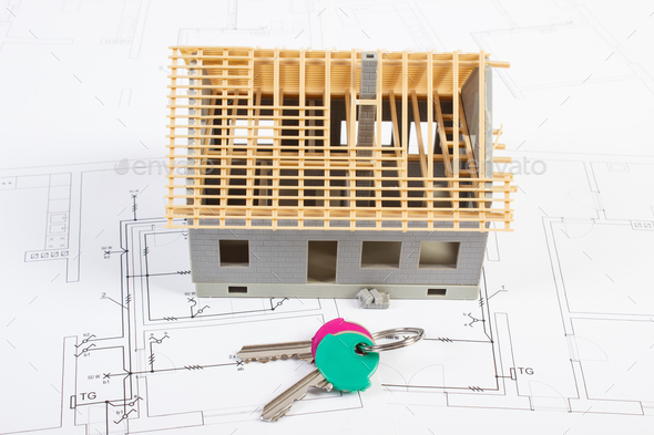 Electrical drawings and diagrams with house under construction and home keys, building home concept - Stock Photo - Images